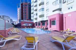 The swimming pool at or near Hotel Quarteirasol