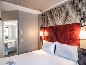 Ένα ή περισσότερα κρεβάτια σε δωμάτιο στο Hotel Ibis Krakow Centrum
