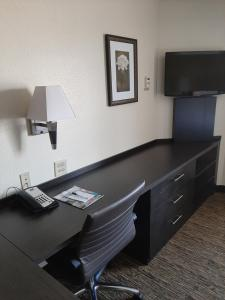 A television and/or entertainment center at Candlewood Suites Aurora-Naperville