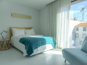 A bed or beds in a room at I Loft Porto