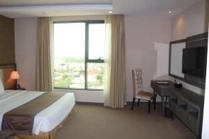 Un ou plusieurs lits dans un hébergement de l'établissement Muong Thanh Luxury Can Tho Hotel