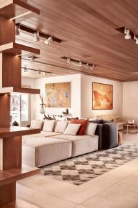 A seating area at Myconian Naia - Preferred Hotels & Resorts
