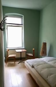 A bed or beds in a room at annabanana Hostel