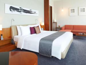 A bed or beds in a room at Novotel Citygate Hong Kong