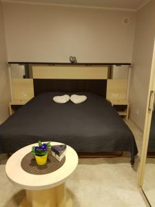 A bed or beds in a room at Cerību Liedags