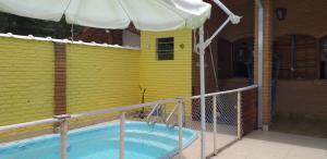 A piscina localizada em Casa do Sergio ou nos arredores
