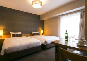 A bed or beds in a room at Hotel Resol Trinity Hakata