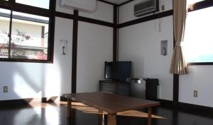 A television and/or entertainment center at Minobu Shizen no Sato