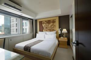 A bed or beds in a room at Quest Hotel & Conference Center - Cebu