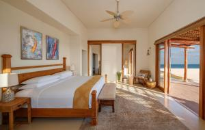 A bed or beds in a room at Anantara Sir Bani Yas Island Al Yamm Villa Resort