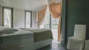 Кровать или кровати в номере Edimonovo village