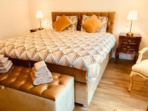 A bed or beds in a room at Boutique Hotel Frada