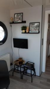 A television and/or entertainment center at Bed-on-a-Boat