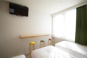 U-Hotel Takadanobabaにあるベッド