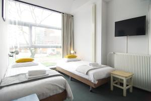 A bed or beds in a room at Stunning apartments close to Amstel river