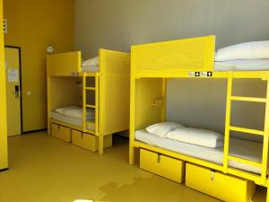 A bunk bed or bunk beds in a room at WOW Amsterdam Hostel
