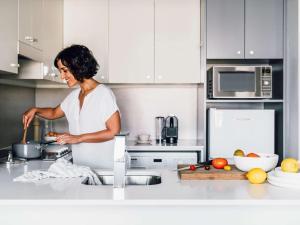 A kitchen or kitchenette at Quay West Suites Melbourne