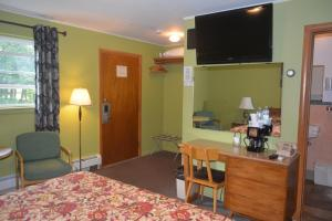 A television and/or entertainment center at The Village Motel