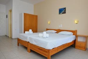 Ein Bett oder Betten in einem Zimmer der Unterkunft Despoina