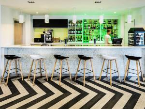 The lounge or bar area at ibis Styles London Heathrow Airport