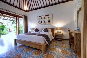 A bed or beds in a room at Wide Sands Beach Retreat