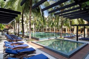 The swimming pool at or near Anantara Hoi An Resort