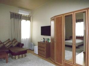 A television and/or entertainment center at Mini Hotel Souz