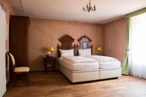 Ein Bett oder Betten in einem Zimmer der Unterkunft Boutique & Business Hotel La Tureta