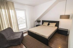 Posteľ alebo postele v izbe v ubytovaní Apartment Unimix