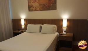 Cama ou camas em um quarto em Premier Parc Hotel