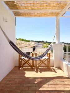 A balcony or terrace at Farmhouse Of The Palms
