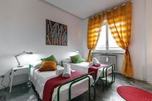 A bed or beds in a room at Residence BIANCA MARIA VISCONTI