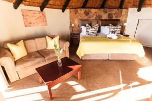 A bed or beds in a room at Kagga Kamma Nature Reserve