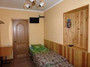 Кровать или кровати в номере Houses Gornolyzhnaya 15