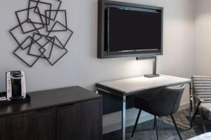 A television and/or entertainment center at Holiday Inn Express - Boston South - Quincy, an IHG Hotel