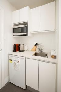 A kitchen or kitchenette at Charlestown Terrace Apartments