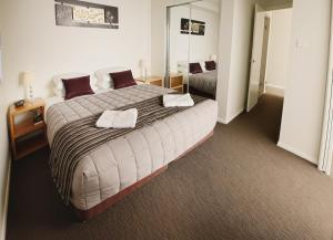 A bed or beds in a room at Charlestown Terrace Apartments