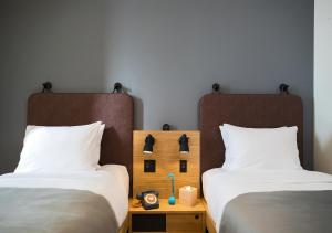 A bed or beds in a room at MOXY Osaka Honmachi by Marriott