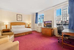 A television and/or entertainment center at Travelodge by Wyndham Downtown Chicago