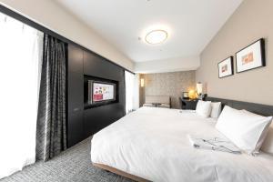 Tempat tidur dalam kamar di Richmond Hotel Nagasaki Shianbashi