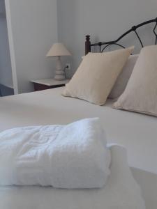 A bed or beds in a room at Emmanouela Studios & Villas