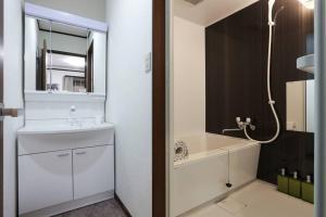 A bathroom at アンドステイ石川町