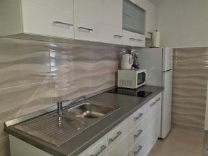 A kitchen or kitchenette at Apartman Nela
