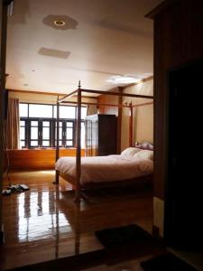 A bunk bed or bunk beds in a room at The Royal ThaTien Village