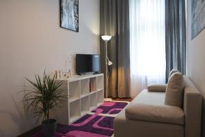 Telewizja i/lub zestaw kina domowego w obiekcie Apartament Staromiejski Zosia