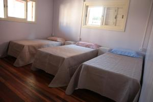 A bed or beds in a room at Hospedagem aconchegante na Serra