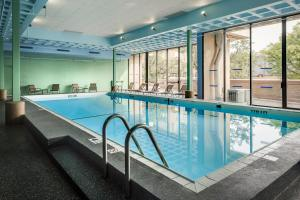 The swimming pool at or near Holiday Inn Rock Island-Quad Cities
