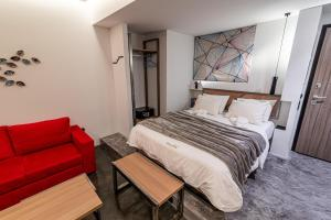 A bed or beds in a room at AthinA STREETAPARTMENTS