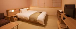 A bed or beds in a room at Onyado Nono