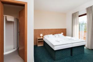 Ein Bett oder Betten in einem Zimmer der Unterkunft Hotel Panska Licha